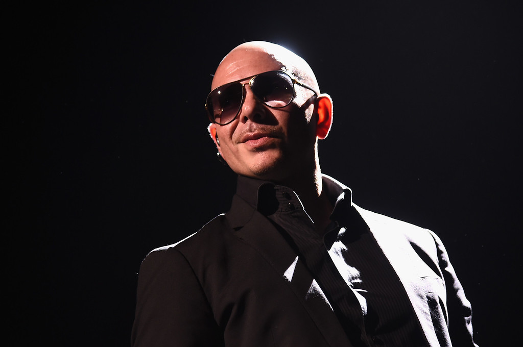 . NEW YORK, NY - JULY 19:  Artist Pitbull performs onstage at a one-of-a-kind concert experience in New York City, PlentiTogether LIVE, bringing to life the better together theme of the first multi-brand rewards program in the U.S., Plenti.  (Photo by Michael Loccisano/Getty Images for Plenti)