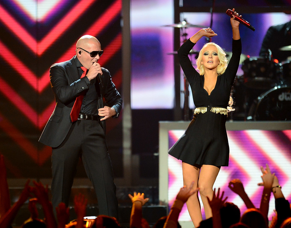 . LAS VEGAS, NV - MAY 19:  Rapper Pitbull (L) and singer Christina Aguilera perform during the 2013 Billboard Music Awards at the MGM Grand Garden Arena on May 19, 2013 in Las Vegas, Nevada.  (Photo by Ethan Miller/Getty Images)