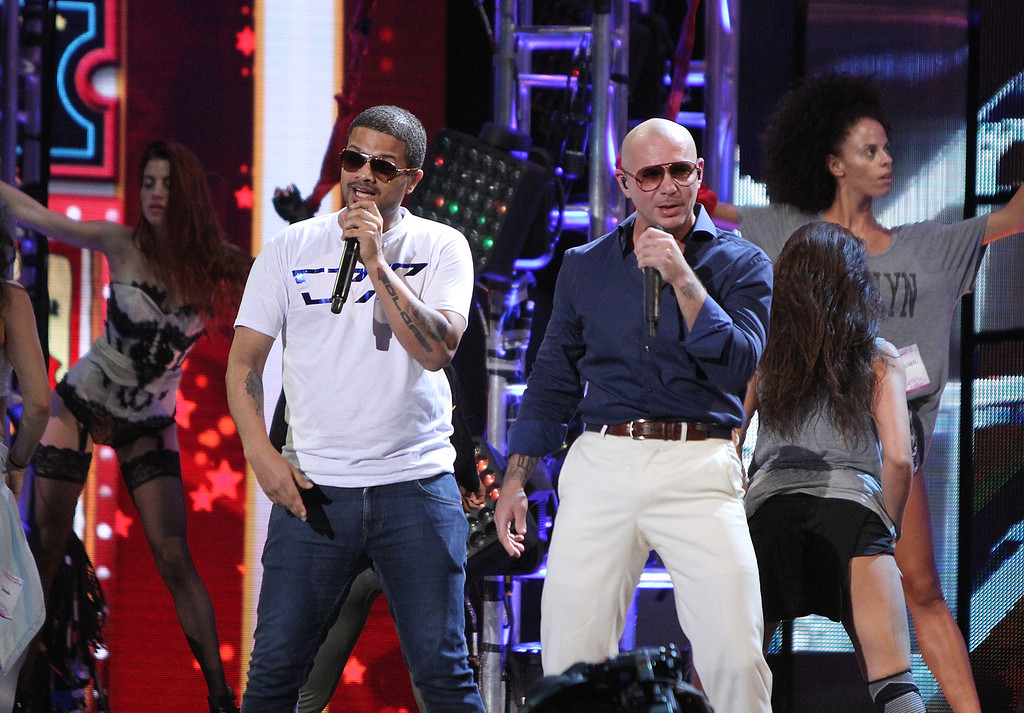 . MIAMI, FL - JULY 16:  Pitbull and Don Miguel perform at the Premios Juventud 2014 Rehearsal at the BankUnited Center on July 16, 2014 in Miami, Florida.  (Photo by John Parra/Getty Images for Univision)