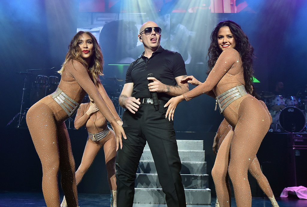. WANTAGH, NY - JUNE 04:  Recording artist Pitbull performs onstage during 103.5 KTU\'s KTUphoria 2016 presented by Aruba, at Nikon at Jones Beach Theater on June 4, 2016 in Wantagh, NY.  (Photo by Theo Wargo/Getty Images for iHeart Media)