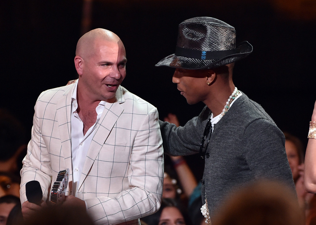 . LOS ANGELES, CA - MAY 01:  Rapper/host Pitbull (L) accepts the Best Collaboration award for \'Timber\' from musician Pharrell Williams onstage during the 2014 iHeartRadio Music Awards held at The Shrine Auditorium on May 1, 2014 in Los Angeles, California.  (Photo by Kevin Winter/Getty Images for Clear Channel)