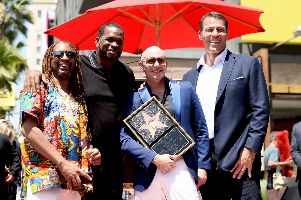 . HOLLYWOOD, CA - JULY 15:  (L-R) Rapper Lil Jon, Luther Campbell, rapper Pitbull, and Tony Robbins attend a ceremony honoring Pitbull with a Star on The Hollywood Walk of Fame on July 15, 2016 in Hollywood, California.  (Photo by Matt Winkelmeyer/Getty Images)