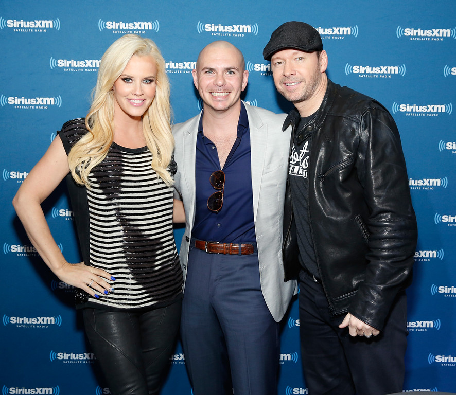 . PHOENIX, AZ - JANUARY 30:  (L-R) TV personality Jenny McCarthy, recording artist Pitbull and singer/actor Donnie Wahlberg attend SiriusXM at Super Bowl XLIX Radio Row at the Phoenix Convention Center on January 30, 2015 in Phoenix, Arizona.  (Photo by Cindy Ord/Getty Images for SiriusXM)