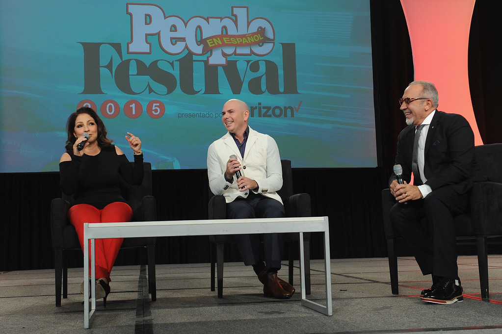 . NEW YORK, NY - OCTOBER 18:  (L-R) Singer-songwriter Gloria Estefan, rapper Pitbull and musician Emilio Estefan speak onstage during Festival PEOPLE En Espanol 2015 presented by Verizon at Jacob Javitz Center on October 18, 2015 in New York City.  (Photo by Brad Barket/Getty Images for PEOPLE En Espanol)