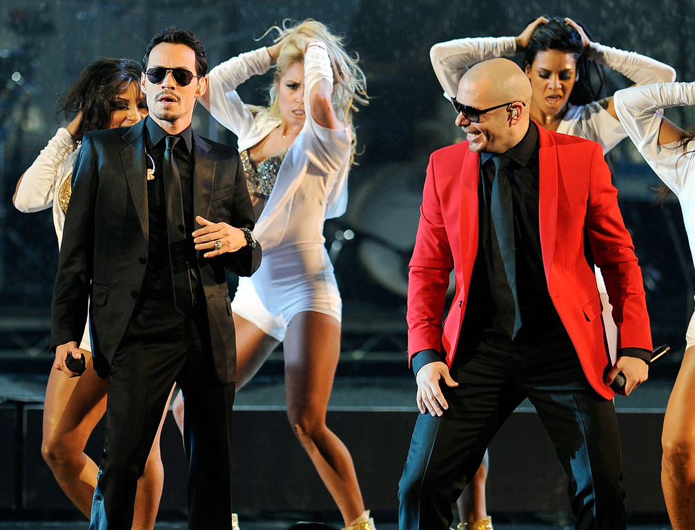 . LOS ANGELES, CA - NOVEMBER 20:  (L-R) Singers Marc Anthony and Pitbull perform onstage at the 2011 American Music Awards held at Nokia Theatre L.A. LIVE on November 20, 2011 in Los Angeles, California.  (Photo by Kevork Djansezian/Getty Images)