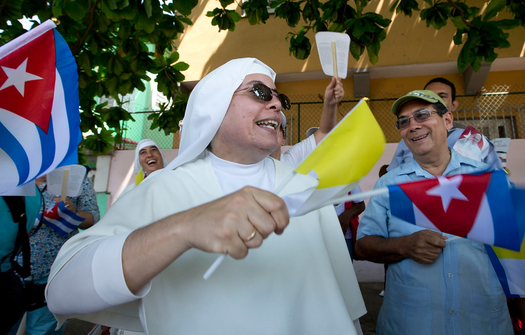 . A nun waits with others for Pope Francis to arrive outside the Apostolic Nunciature in Havana, Cuba, Saturday, Sept. 19, 2015. Pope Francis begins a 10-day trip to Cuba and the United States on Saturday, embarking on his first trip to the onetime Cold War foes after helping to nudge forward their historic rapprochement.  (AP Photo/Alessandra Tarantino)