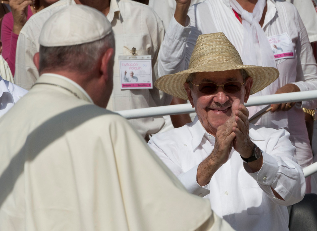 . Cuba\'s President Raul Castro applauds as Pope Francis arrives at the Plaza of the Revolution to celebrate a Mass, in Holguin, Cuba, Monday, Sept. 21, 2015. Holguin\'s plaza was packed with thousands of people waving flags as Francis traveled in his popemobile through the crowd. Francis is the first pope to visit Holguin, Cuba\'s third-largest city. (AP Photo/Alessandra Tarantino)