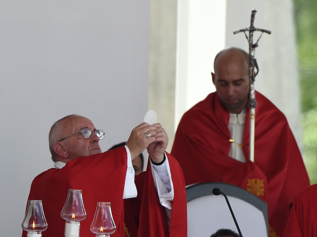 . Pope Francis (L) gives a morning mass at the Calixto Garcia square in Holguin, in eastern Cuba, on September 21, 2015. Holguin, a cradle of Catholic faith on the island and also the home region of communist leaders Fidel and Raul Castro, is the only stop on the pope\'s eight-day, six-city tour of Cuba and the United States that has never received a papal visit.           (LUIS ACOSTA/AFP/Getty Images)