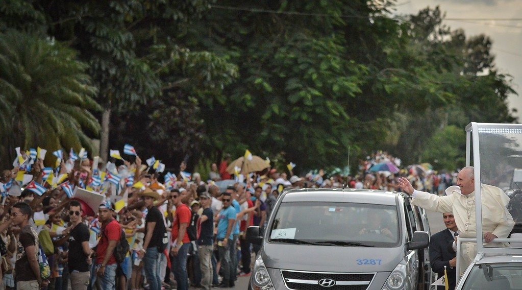 . Pope Francis waves from the Popemobile as he is driven from Jose Marti airport to the Havana\'s downtown, on September 19, 2015. Pope Francis on Saturday urged the United States and Cuba to build on their nascent reconciliation as he arrived in Havana for the first leg of a high-profile trip that will also take him to America.          (ADALBERTO ROQUE/AFP/Getty Images)