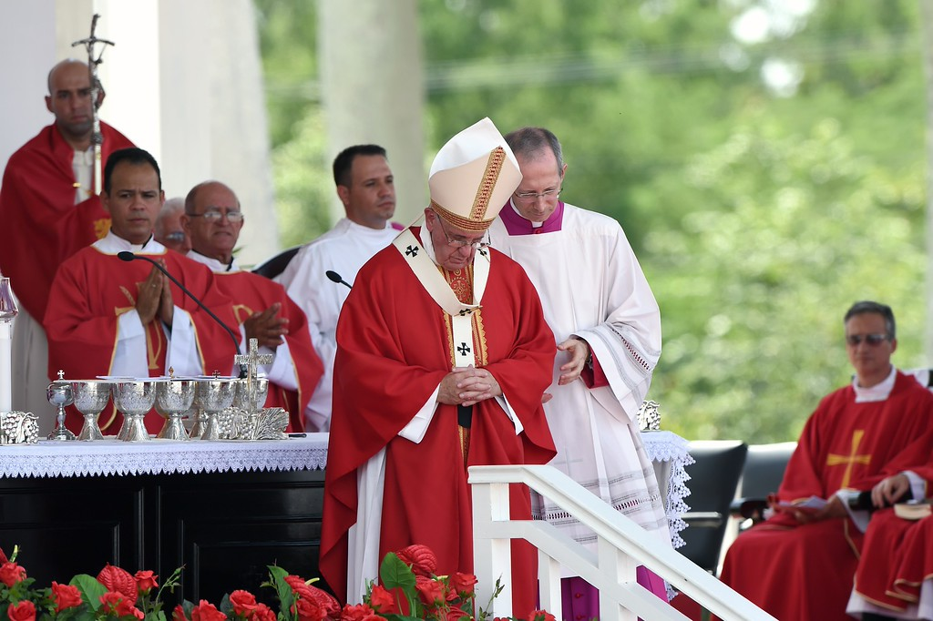 . Pope Francis (C) officiates an open mass at Calixto Garcia Square in Holguin, eastern Cuba, on September 21, 2015. Holguin, a cradle of Catholic faith on the island and also the home region of communist leaders Fidel and Raul Castro, is the only stop on the pope\'s eight-day, six-city tour of Cuba and the United States that has never received a papal visit.          (LUIS ACOSTA/AFP/Getty Images)