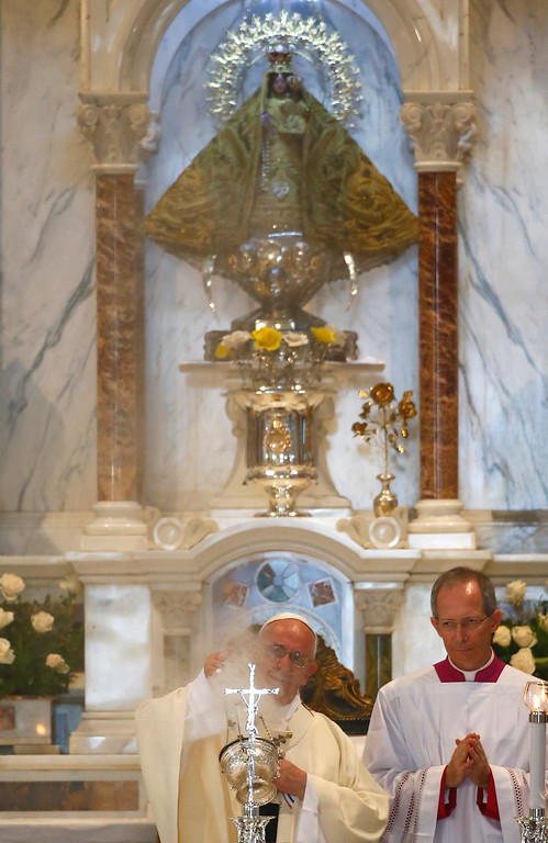 . Pope Francis leads Mass in the sanctuary of the Virgin of Charity, or Our Lady of El Cobre, in El Cobre, Cuba, Tuesday, Sept. 22, 2015. On Tuesday, Pope Francis wraps up his visit to Cuba, where around 10 percent regularly attend Mass and many more believe in religious icons like the Virgin of Charity of Cobre, whose sanctuary is important to both observant Catholics and followers of Afro-Cuban Santeria traditions. (Tony Gentile/Pool via AP)