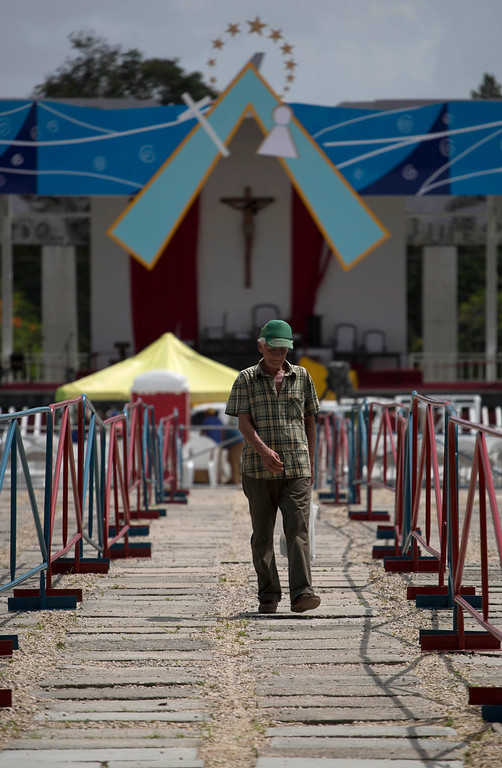 . A man walks at the site where Pope Francis will celebrate Mass in Revolution Plaza in Holguin, Cuba, Saturday, Sept. 19, 2015. Hundreds of people are planning to take buses or trains across long, winding route through Cuba\'s rural heartland to see Pope Francis appear in Havana to the west or Holguin and Santiago to the east. (AP Photo/Eduardo Verdugo)