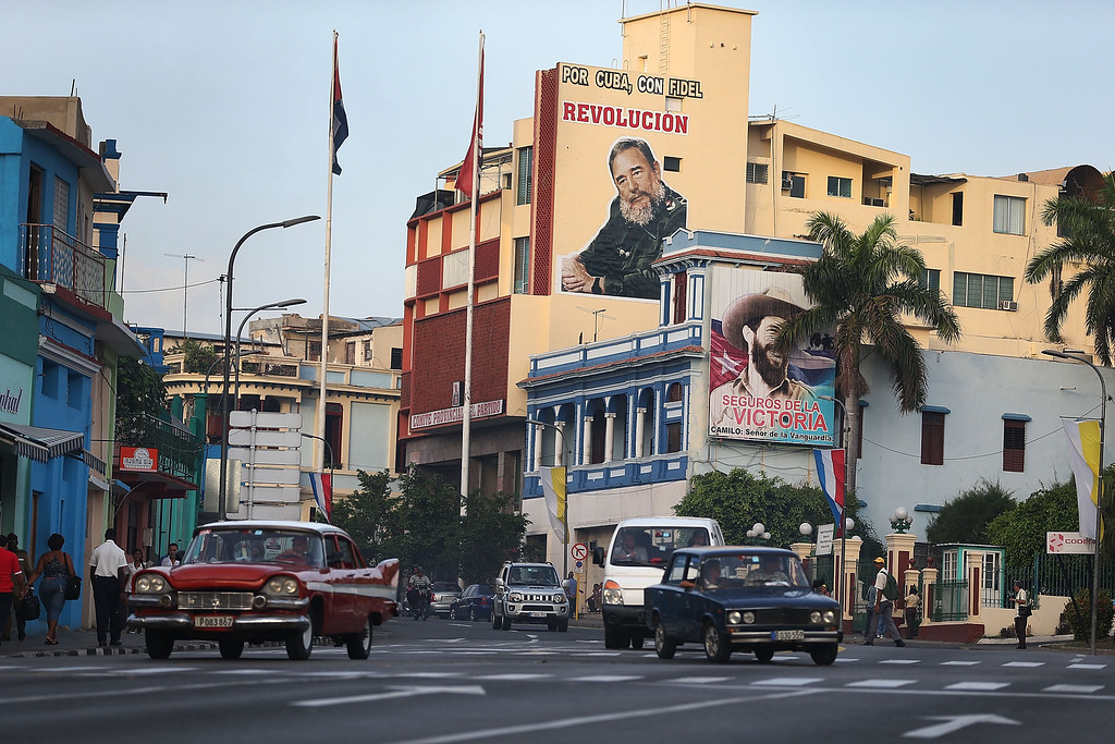 . A billboard of Cuban Revolutionary leader and former President Fidel Castro is seen as Cuba prepares to welcome Pope Francis for a visit on September 19, 2015 in Santiago de Cuba, Cuba. Pope Francis is due to arrive today in Havana, Cuba for a three day visit where he will meet President Raul Castro and hold Mass in Revolution Square before travelling to Holguin, Santiago de Cuba and onwards to the United States.  (Photo by Joe Raedle/Getty Images)