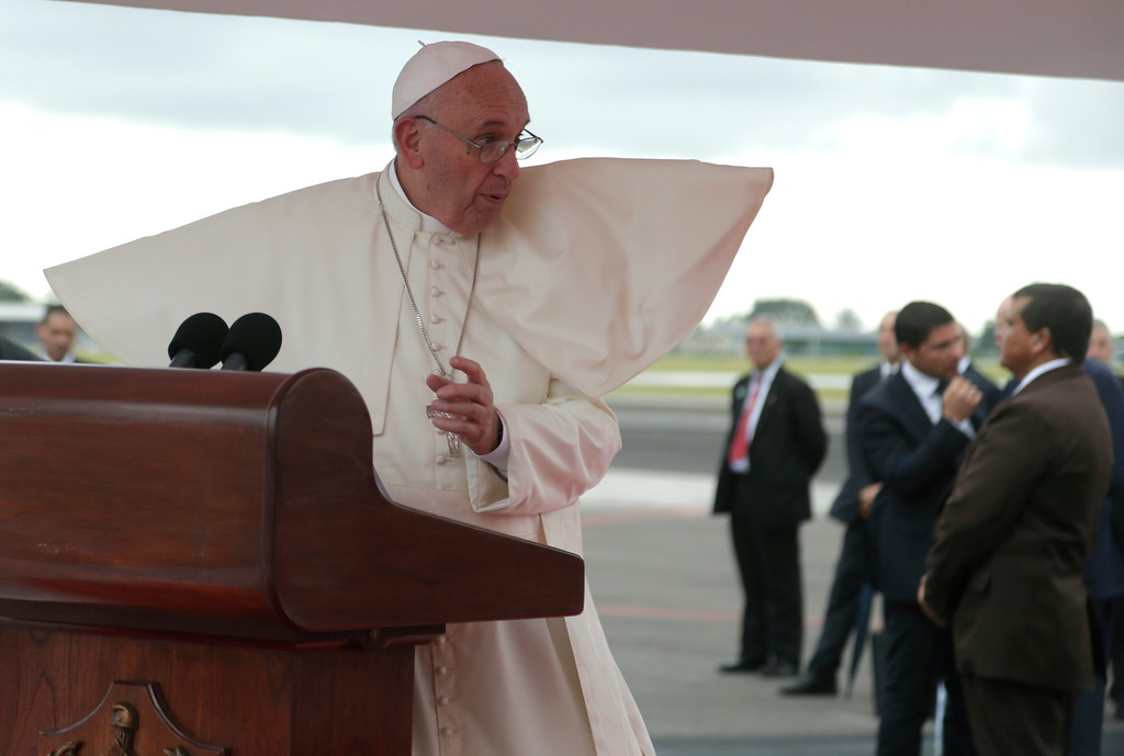 . Pope Francis\' robe is lifted by the wind at the podium during his arrival ceremony in Havana, Cuba, Saturday, Sept. 19, 2015. Pope Francis began his 10-day trip to Cuba and the United States, embarking on his first trip to the onetime Cold War foes after helping to nudge forward their historic rapprochement. (Ismael Francisco/Cubadebate Via AP)