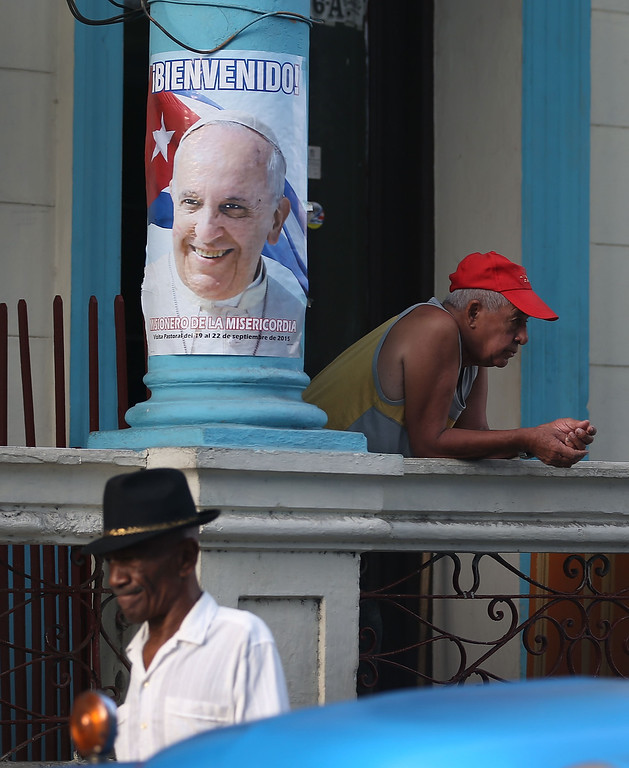 . A poster welcoming Pope Francis is seen as Cuba prepares for the pontiff\'s visit on September 19, 2015 in Santiago de Cuba, Cuba. Pope Francis is due to arrive in Havana today for a three day visit where he will meet President Raul Castro and hold Mass in Revolution Square before travelling to Holguin, Santiago de Cuba and onwards to the United States.  (Photo by Joe Raedle/Getty Images)