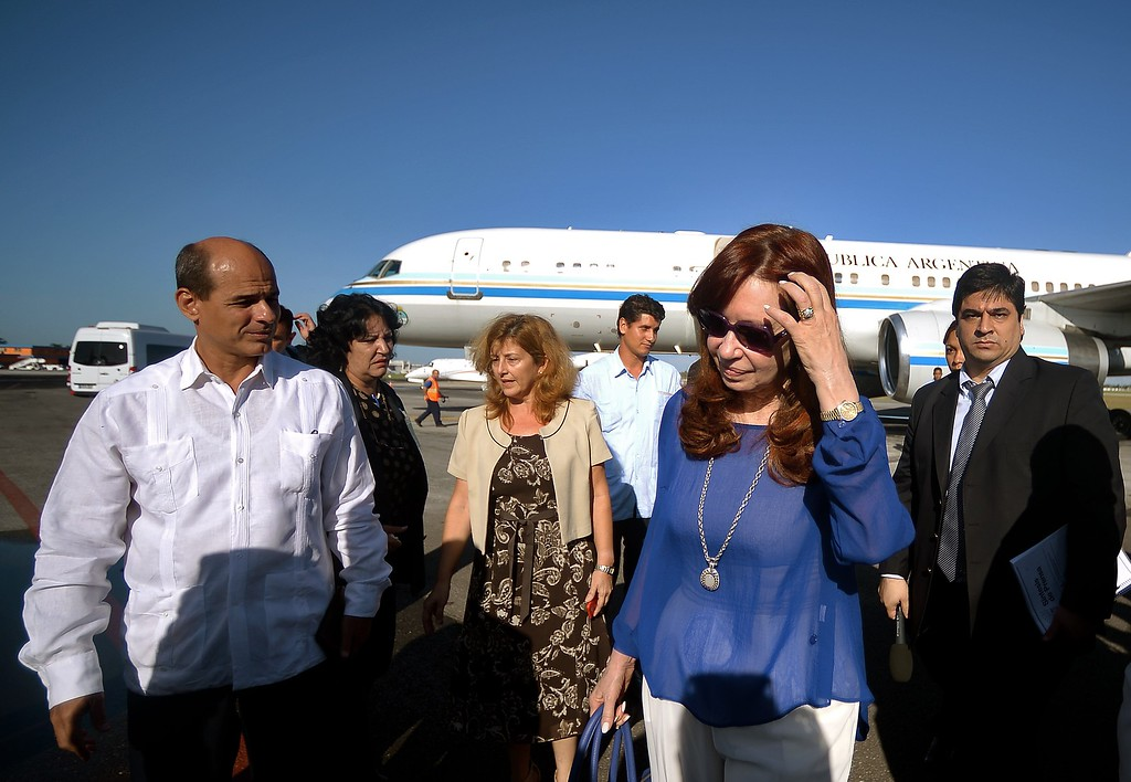 . Argentina\'s President Cristina Fernandez de Kirchner (2-R) arrives at Havana\'s Jose Marti International Airport on September 19, 2015 for the visit of Pope Francis to Cuba. Pope Francis is expected to arrive in the island nation on Saturday, for the first leg of a trip which will also take him to the United States.          (FILIPPO MONTEFORTE/AFP/Getty Images)