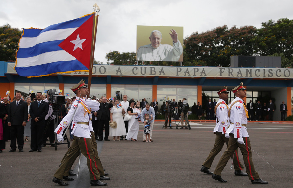 . Soldiers march inside the airport during the arrival ceremony for Pope Francis in Havana, Cuba, Saturday, Sept. 19, 2015. Pope Francis began his 10-day trip to Cuba and the United States, embarking on his first trip to the onetime Cold War foes after helping to nudge forward their historic rapprochement. (Ismael Francisco/Cubadebate Via AP)