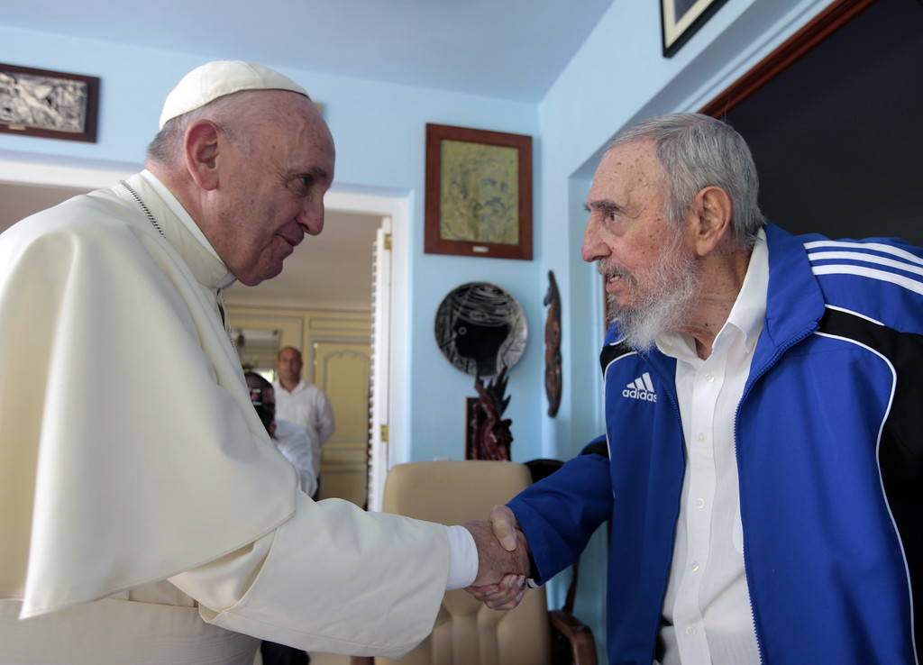 . Pope Francis and Cuba\'s Fidel Castro shakes hands, in Havana, Cuba, Sunday, Sept. 20, 2015. The Vatican described the 40-minute meeting at Castro\'s residence as informal and familial, with an exchange of books. (AP Photo/Alex Castro)