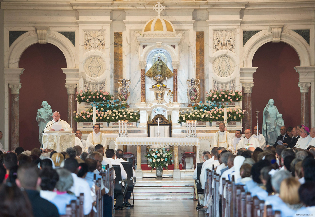 . Pope Francis, top left, celebrates a Mass at the Sanctuary of the Virgin of Charity of El Cobre, in El Cobre, Cuba, Tuesday, Sept. 22, 2015. The pontiff\'s homily in the Sanctuary of the Virgin of Charity of El Cobre was the latest in a series of carefully worded critiques of the Cuban system during his four-day trip. (L\'Osservatore Romano/Pool Photo via AP)