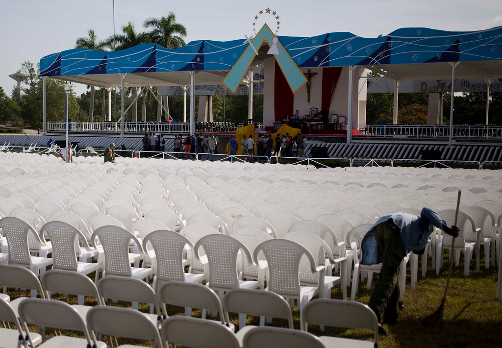 . A worker cleans the site where Pope Francis will celebrate Mass in Revolution Plaza in Holguin, Cuba, Saturday, Sept. 19, 2015, on the day the pope arrives to Cuba. Fewer than a third of Cubans identify as Catholic, but rural Cubans are speaking warmly of the pope\'s role in mediating detente between the U.S. and Cuba. (AP Photo/Eduardo Verdugo)