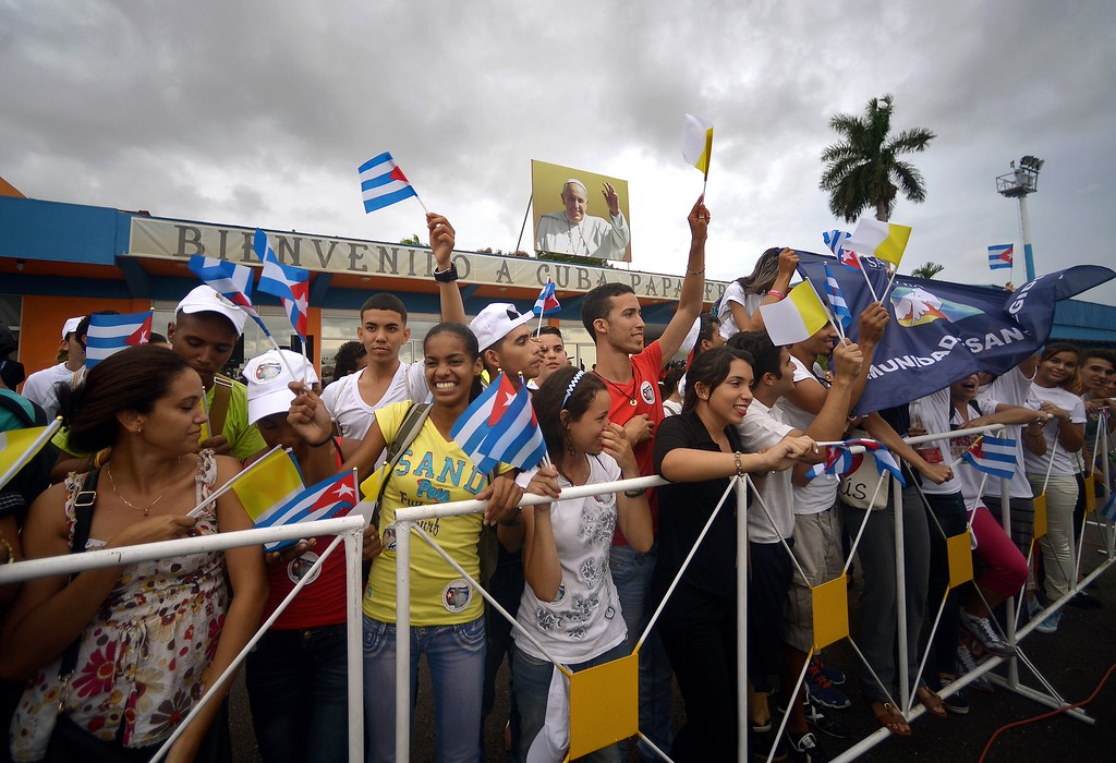 . Cubans wait for the passage of Pope Francis in Havana on September 19, 2015, on the first leg of a high-profile trip that will also take him to the United States.         (FILIPPO MONTEFORTE/AFP/Getty Images)