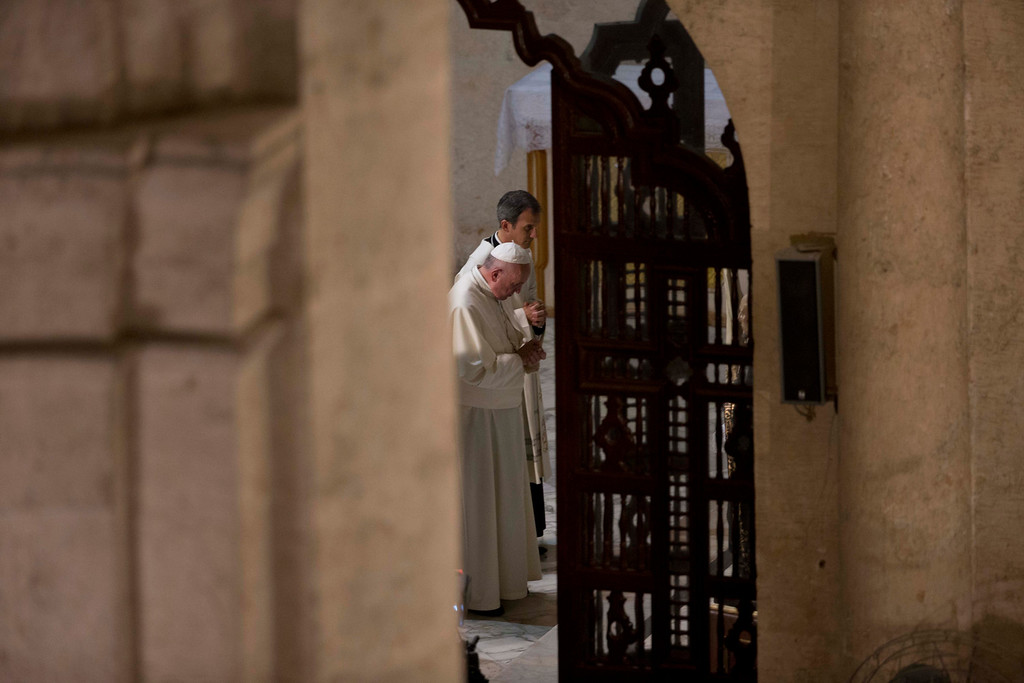 . Pope Francis stands with head bowed after arriving for a vespers service at the San Cristobal cathedral, Havana, Cuba, Sunday, Sept. 20, 2015. Francis presided over the evening prayer service in Havana\'s 18th century cathedral, where he broke from prepared remarks and spoke off-the-cuff at length for the first time during his trip to Cuba. (AP Photo/Alessandra Tarantino)