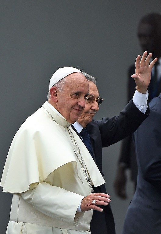 . Pope Francis (L) is welcomed by Cuban President Raul Castro at Havana\'s international airport on September 19, 2015 on the first leg of a high-profile trip that will also take him to the United States. The Alitalia plane carrying Pope Francis touched down at Havana\'s Jose Marti airport at 3:50 pm (1950 GMT), as thousands of people lined the road into the city, which was decked out in giant posters of the Argentine pontiff.          (FILIPPO MONTEFORTE/AFP/Getty Images)