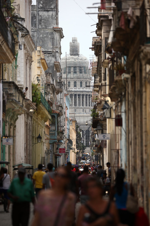 . The National Capitol Building is pictured at the far end of a street on September 18, 2015 in Havana, Cuba. Pope Francis is due to make a three day visit to Cuba from September 19 where he will meet President Raul Castro and hold Mass in Revolution Square before travelling to Holguin, Santiago de Cuba, El Cobre and onwards to the United States. (Photo by Carl Court/Getty Images)