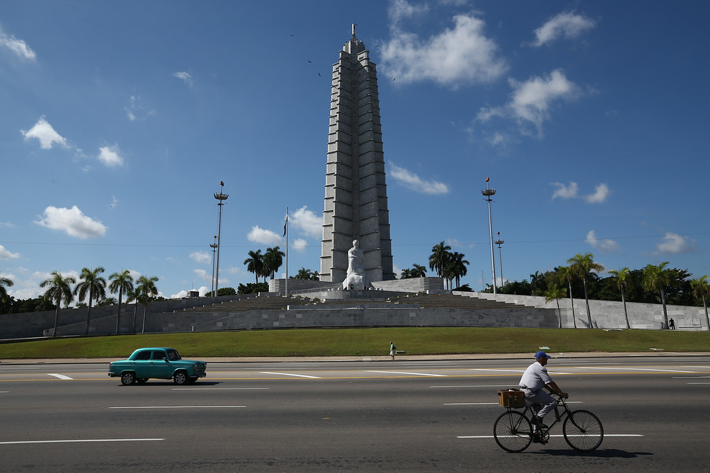 . A cyclist, taxi and pedestrian pass the Jose Marti Memorial in Revolution Square where Pope Francis will perform Mass during his visit to Havana, on September 18, 2015 in Havana, Cuba. Pope Francis is due to make a three day visit to Cuba from September 19 where he will meet President Raul Castro and hold Mass in Revolution Square before travelling to Holguin, Santiago de Cuba, El Cobre and onwards to the United States. (Photo by Carl Court/Getty Images)