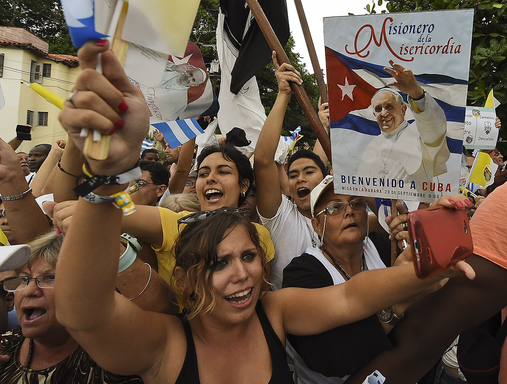 . Cubans wait for the passage of Pope Francis in Havana on September 19, 2015, on the first leg of a high-profile trip that will also take him to the United States.        (LUIS ACOSTA/AFP/Getty Images)