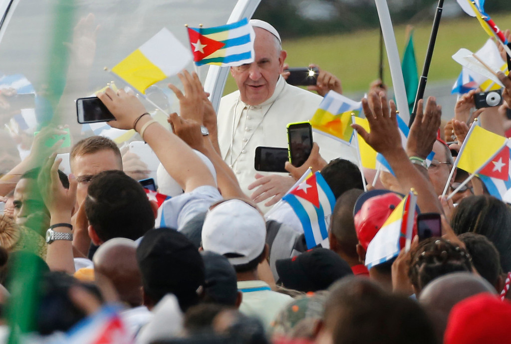 . Pope Francis arrives for Mass at Revolution Plaza in Havana, Cuba, Sunday, Sept. 20, 2015. Pope Francis opens his first full day in Cuba on Sunday with what normally would be the culminating highlight of a papal visit: Mass before hundreds of thousands of people in Havana\'s Revolution Plaza. (AP Photo/Desmond Boylan)