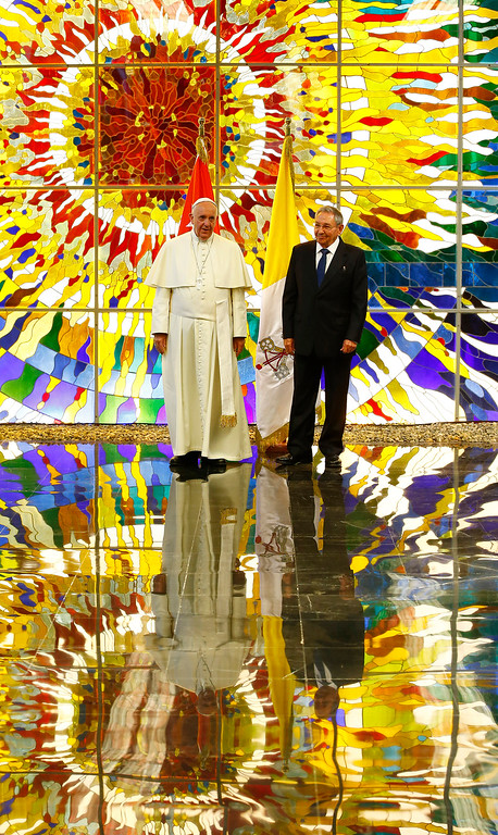 . Pope Francis stands with Cuba\'s President Raul Castro in the Revolution Palace in Havana, Cuba, Sept. 20, 2015. Francis and Castro met in Cuba\'s seat of government, for a state meeting. (Tony Gentile/Pool via AP)