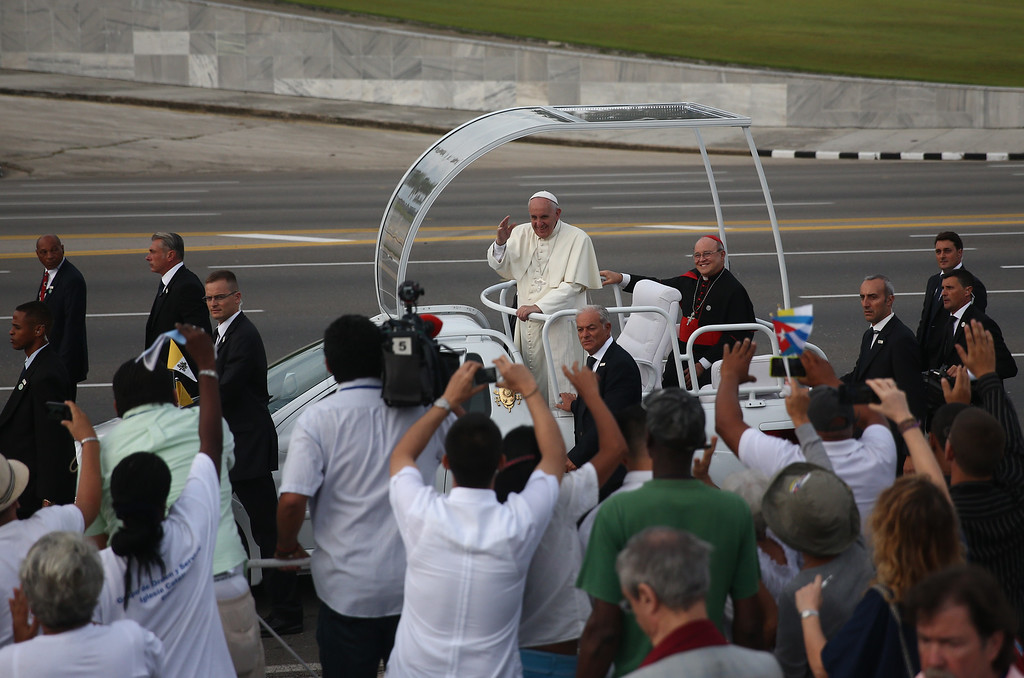 . Pope Francis waves as he arrives to perform Mass on September 20, 2015 in Revolution Square in Havana, Cuba. Pope Francis is on the first full day of his three day visit to Cuba where he will meet President Raul Castro and hold Mass in Revolution Square before travelling to Holguin, Santiago de Cuba and El Cobre then onwards to the United States.  (Photo by Carl Court/Getty Images)
