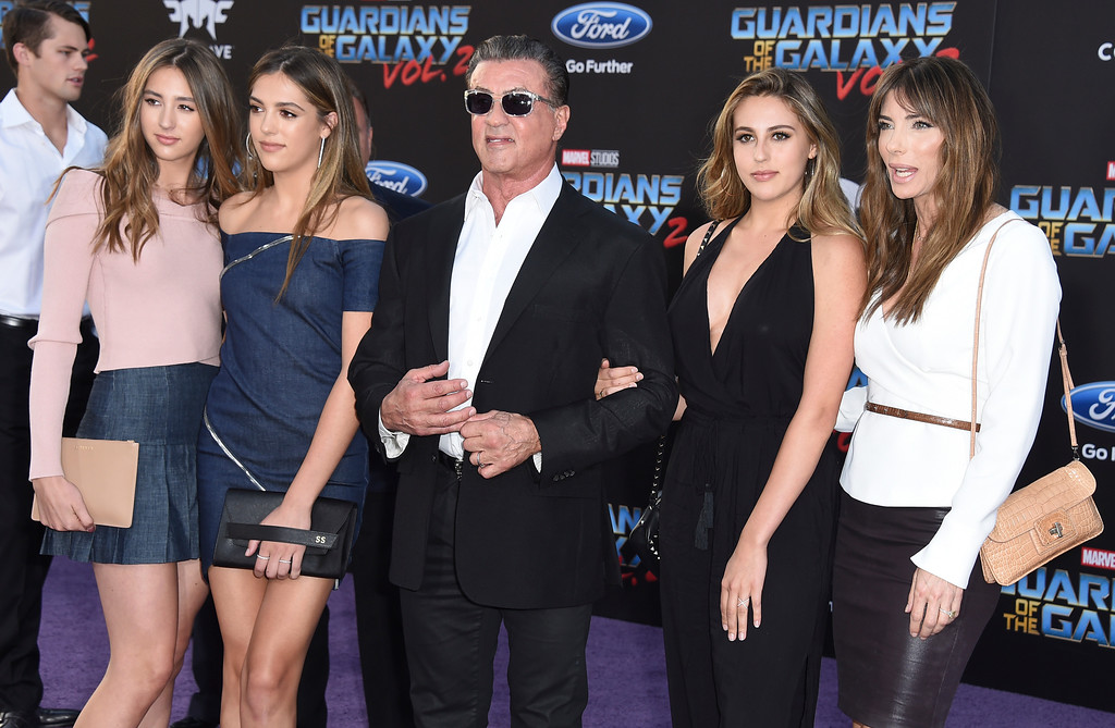 ". Scarlet Rose Stallone, from left, Sistine Rose Stallone, Sylvester Stallone, Sophia Rose Stallone and Jennifer Flavin arrive at the world premiere of ""Guardians of the Galaxy Vol. 2\"" at the Dolby Theatre on Wednesday, April 19, 2017, in Los Angeles. (Photo by Jordan Strauss/Invision/AP)"