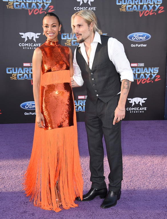 ". Zoe Saldana, left, and Marco Perego arrive at the world premiere of ""Guardians of the Galaxy Vol. 2\"" at the Dolby Theatre on Wednesday, April 19, 2017, in Los Angeles. (Photo by Jordan Strauss/Invision/AP)"