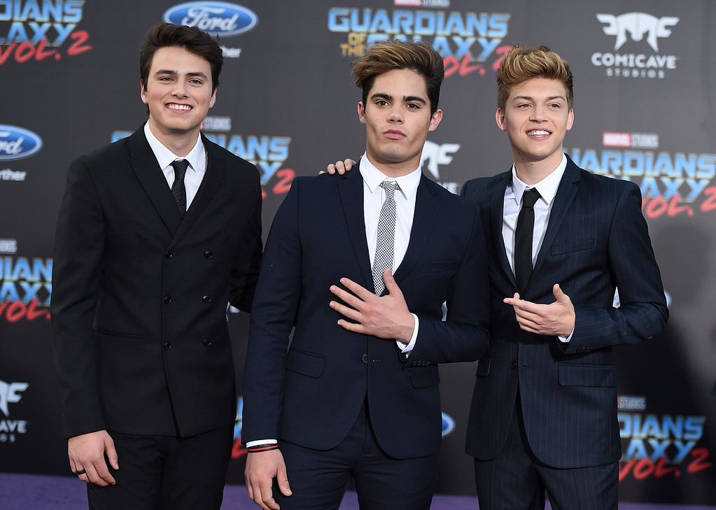 ". Liam Attridge, from left, Emery Kelly and Ricky Garcia, of Forever In Your Mind, arrive at the world premiere of ""Guardians of the Galaxy Vol. 2\"" at the Dolby Theatre on Wednesday, April 19, 2017, in Los Angeles. (Photo by Jordan Strauss/Invision/AP)"