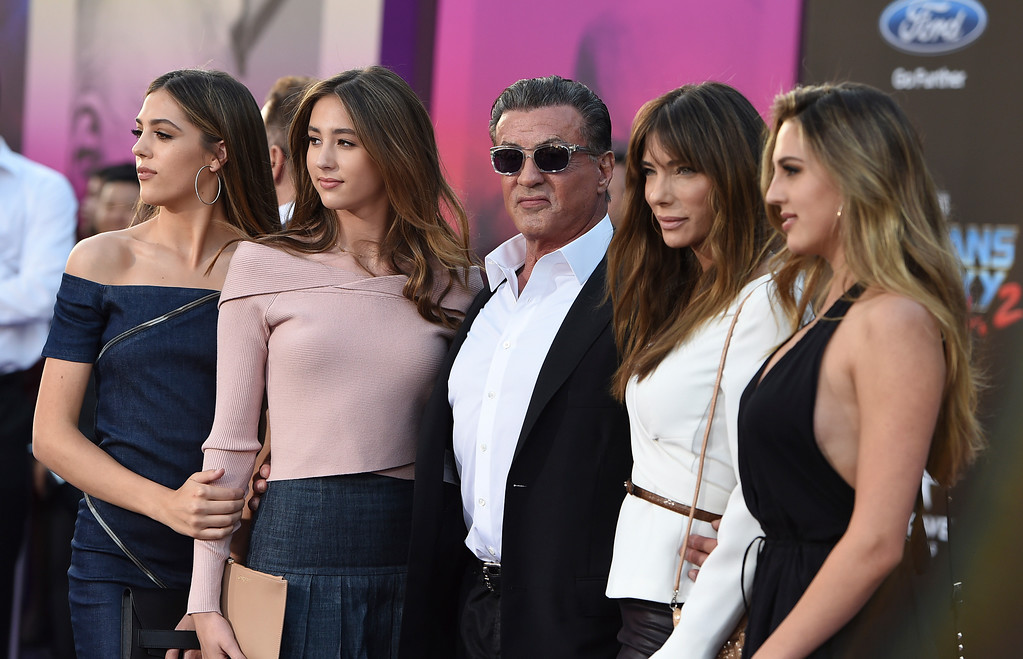 ". Sistine Rose Stallone, from left, Scarlet Rose Stallone, Sylvester Stallone, Jennifer Flavin and Sophia Rose Stallone arrive at the world premiere of ""Guardians of the Galaxy Vol. 2\"" at the Dolby Theatre on Wednesday, April 19, 2017, in Los Angeles. (Photo by Jordan Strauss/Invision/AP)"