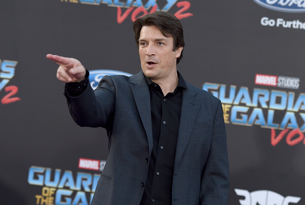 ". Nathan Fillion arrives at the world premiere of ""Guardians of the Galaxy Vol. 2\"" at the Dolby Theatre on Wednesday, April 19, 2017, in Los Angeles. (Photo by Jordan Strauss/Invision/AP)"