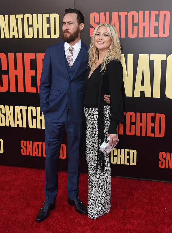 ". Danny Fujikawa, left, and Kate Hudson arrive at the Los Angeles premiere of ""Snatched\"" at the Regency Village Theatre on Wednesday, May 10, 2017. (Photo by Jordan Strauss/Invision/AP)"
