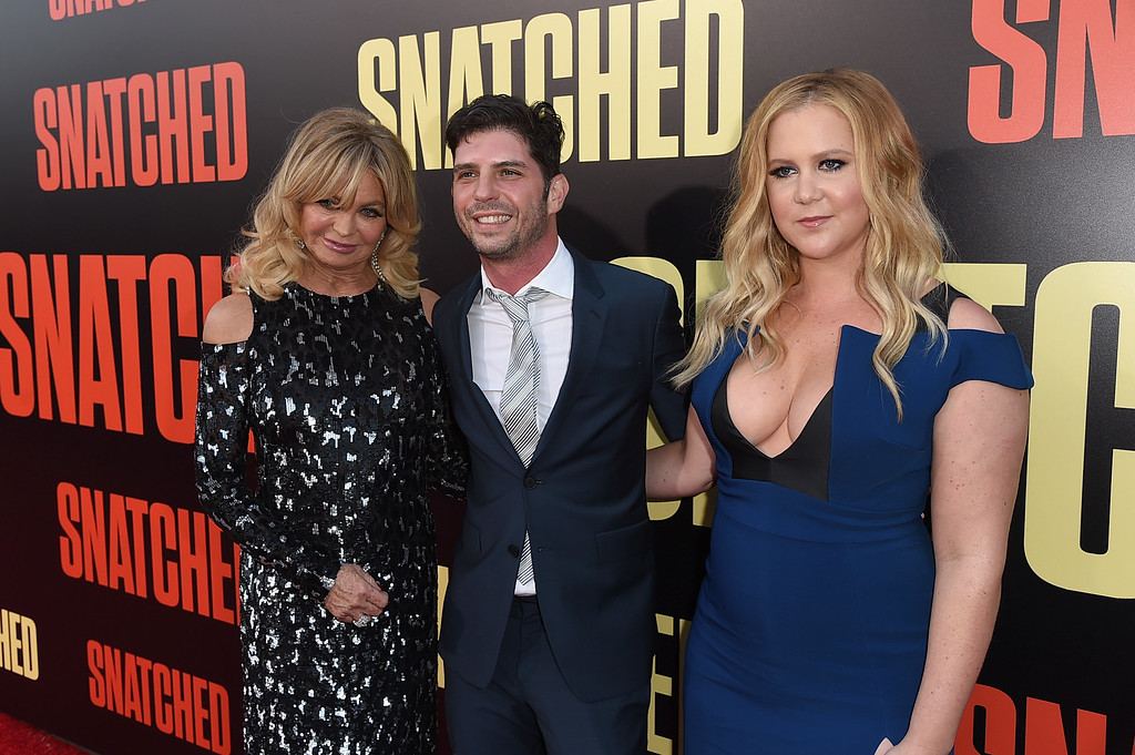 ". WESTWOOD, CA - MAY 10:  (L-R) Actor Goldie Hawn, filmmaker Jonathan Levine, and actor/executive producer Amy Schumer attend the premiere of 20th Century Fox\'s ""Snatched\"" at Regency Village Theatre on May 10, 2017 in Westwood, California.  (Photo by Kevin Winter/Getty Images)"
