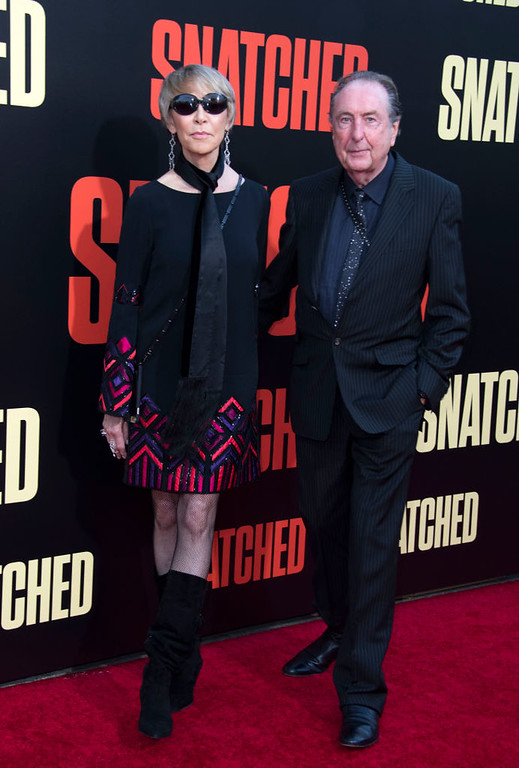 ". Actor Eric Idle (R) attends the world premiere of ""Snatched\"" at the Regency Village Theater, on May 10, 2017, in Westwood, California. (VALERIE MACON/AFP/Getty Images)"