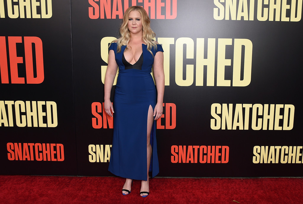 ". Amy Schumer arrives at the Los Angeles premiere of ""Snatched\"" at the Regency Village Theatre on Wednesday, May 10, 2017. (Photo by Jordan Strauss/Invision/AP)"