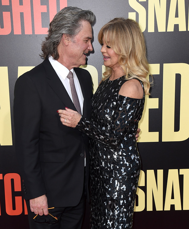 ". Kurt Russell, left, and Goldie Hawn arrive at the Los Angeles premiere of ""Snatched\"" at the Regency Village Theatre on Wednesday, May 10, 2017. (Photo by Jordan Strauss/Invision/AP)"