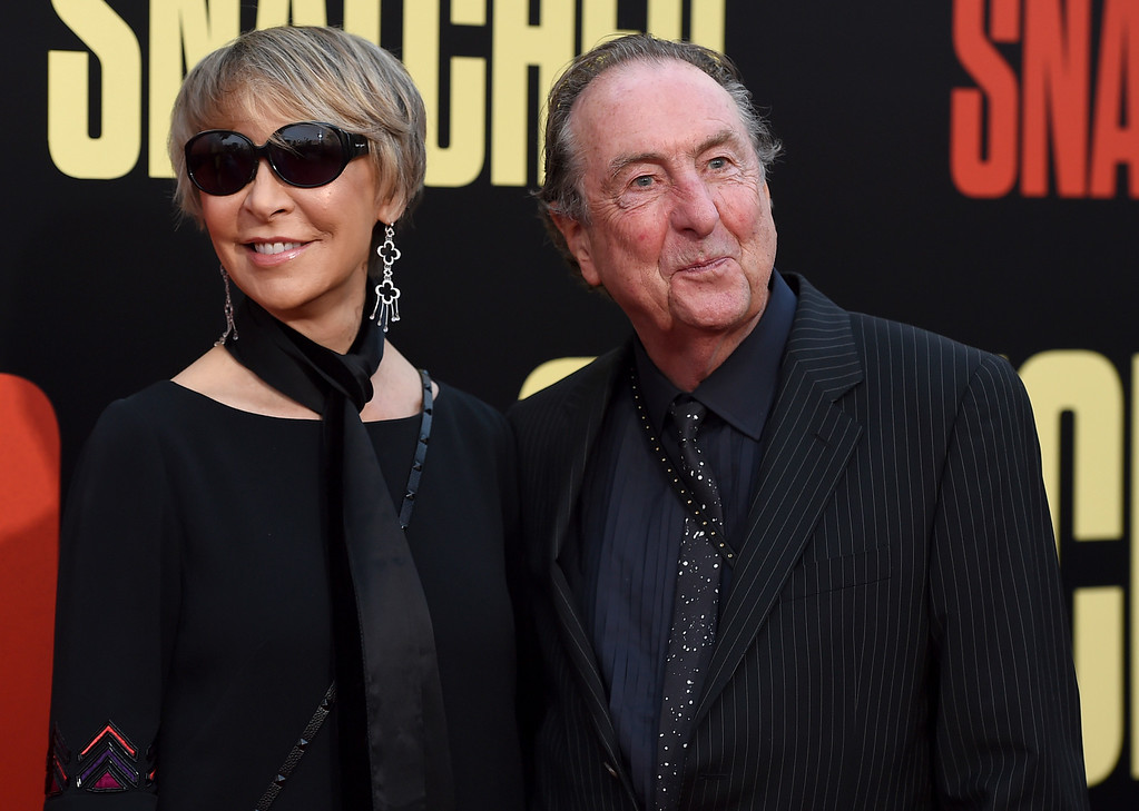 ". Tania Kosevich, left, and Eric Idle arrive at the Los Angeles premiere of ""Snatched\"" at the Regency Village Theater on Wednesday, May 10, 2017. (Photo by Jordan Strauss/Invision/AP)"