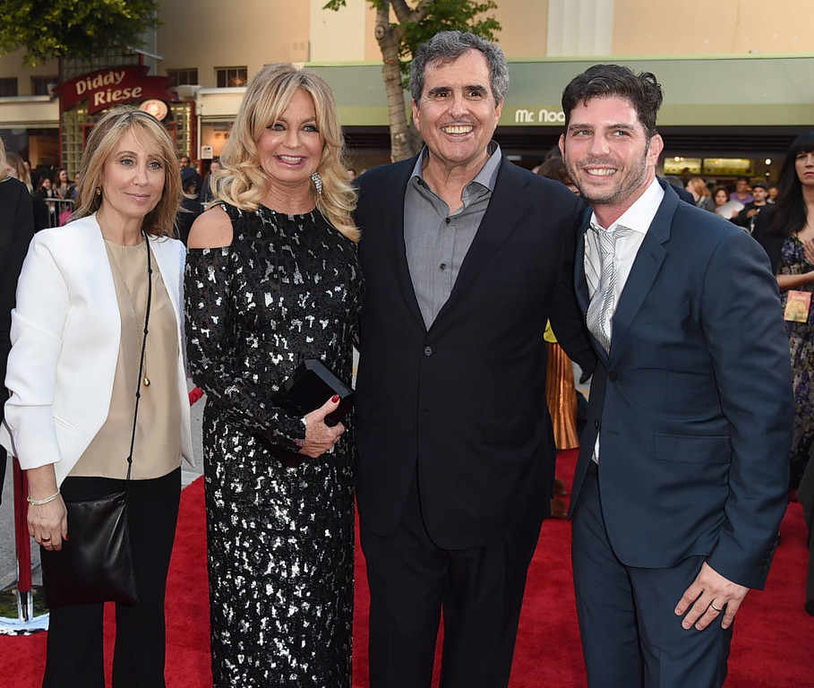 ". LOS ANGELES, CA - MAY 10:  (L-R) Stacey Snider, Chairman/CEO, 20th Century Fox, actress Goldie Hawn, producer Peter Chernin and director Jonathan Levine arrive at the premiere of 20th Century Fox\'s ""Snatched\"" at the Village Theatre on May 10, 2017 in Los Angeles, California.  (Photo by Kevin Winter/Getty Images)"