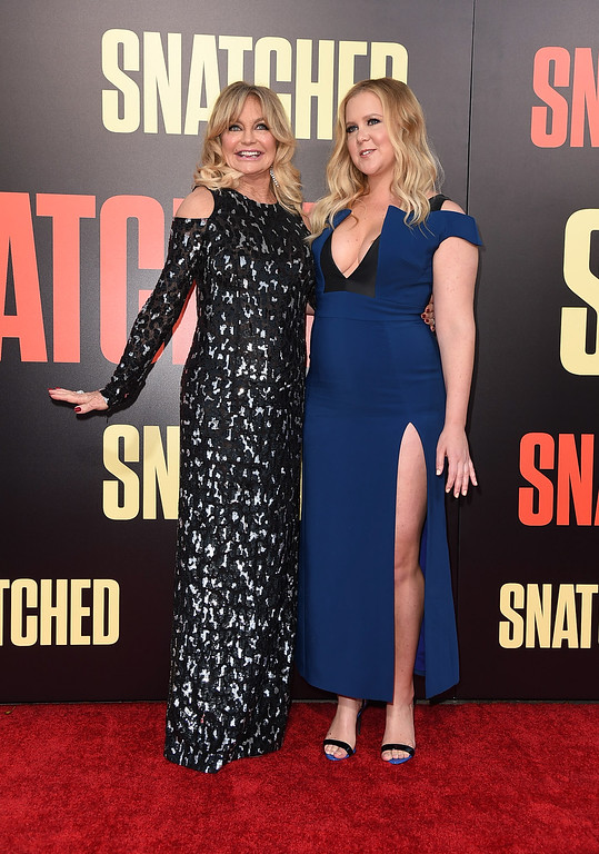 ". WESTWOOD, CA - MAY 10:  Actor Goldie Hawn (L) and actor/executive producer Amy Schumer attend the premiere of 20th Century Fox\'s ""Snatched\"" at Regency Village Theatre on May 10, 2017 in Westwood, California.  (Photo by Kevin Winter/Getty Images)"