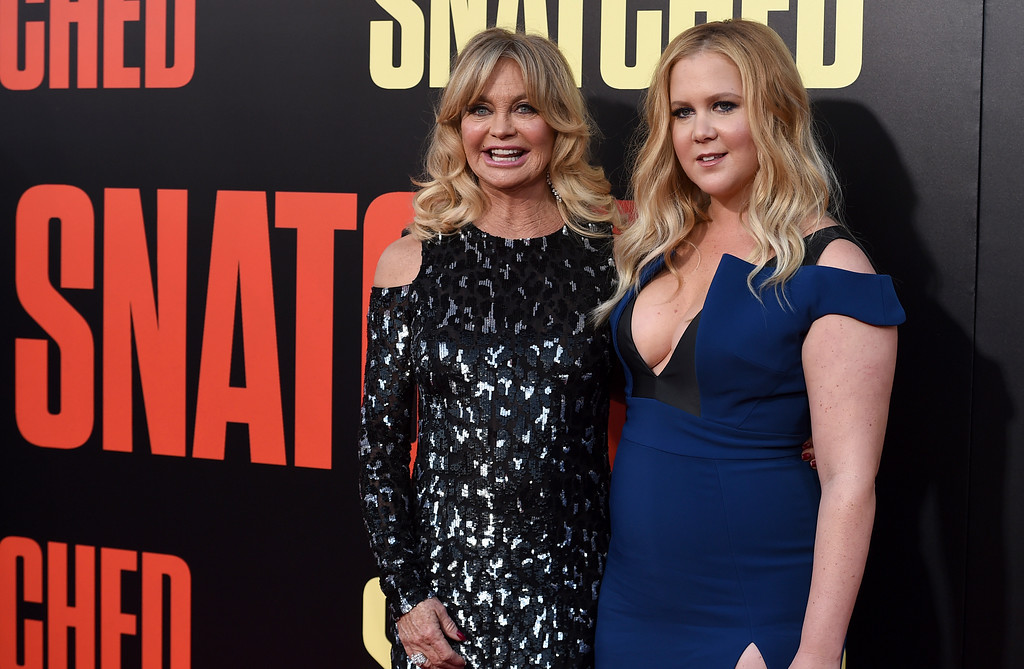 ". Goldie Hawn, left, and Amy Schumer arrive at the Los Angeles premiere of ""Snatched\"" at the Regency Village Theatre on Wednesday, May 10, 2017. (Photo by Jordan Strauss/Invision/AP)"