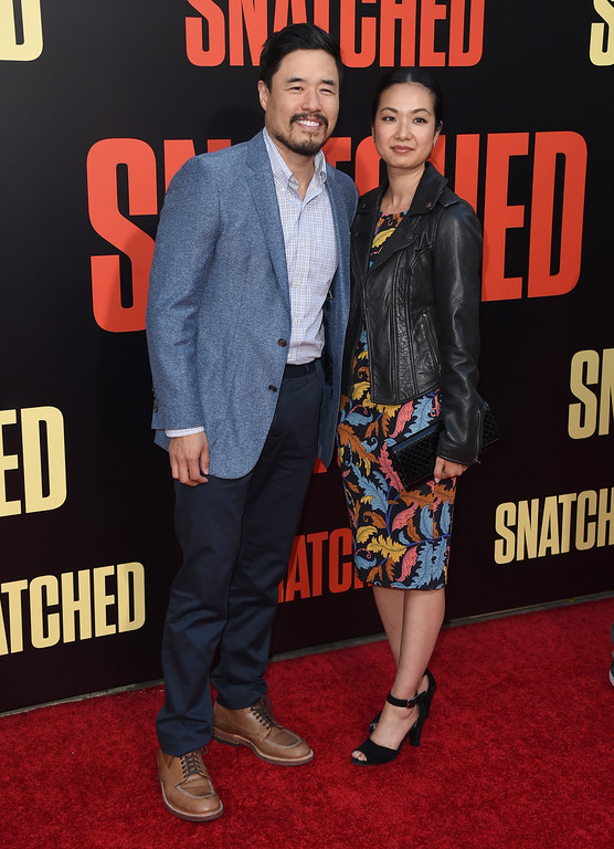 ". Randall Park, left, and Jae W. Suh arrive at the Los Angeles premiere of ""Snatched\"" at the Regency Village Theatre on Wednesday, May 10, 2017. (Photo by Jordan Strauss/Invision/AP)"
