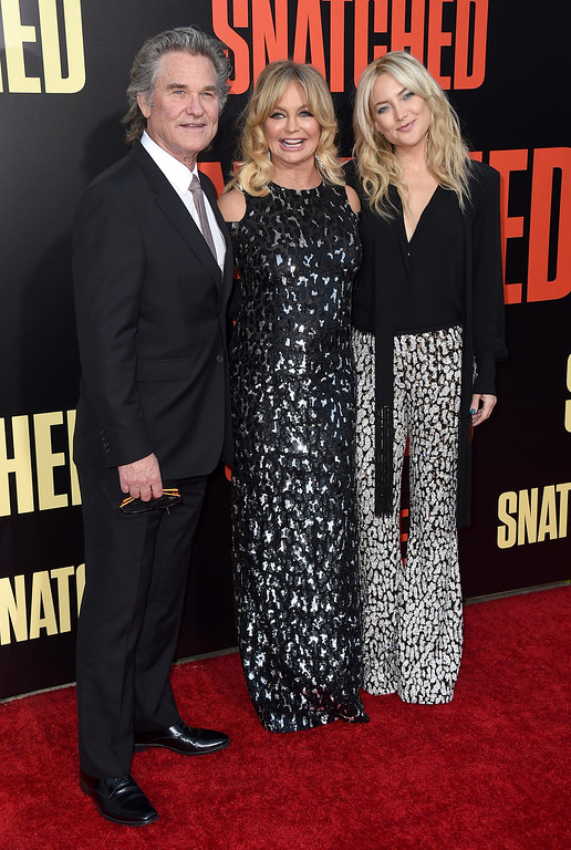 ". Kurt Russell, from left, Goldie Hawn and Kate Hudson arrive at the Los Angeles premiere of ""Snatched\"" at the Regency Village Theatre on Wednesday, May 10, 2017. (Photo by Jordan Strauss/Invision/AP)"