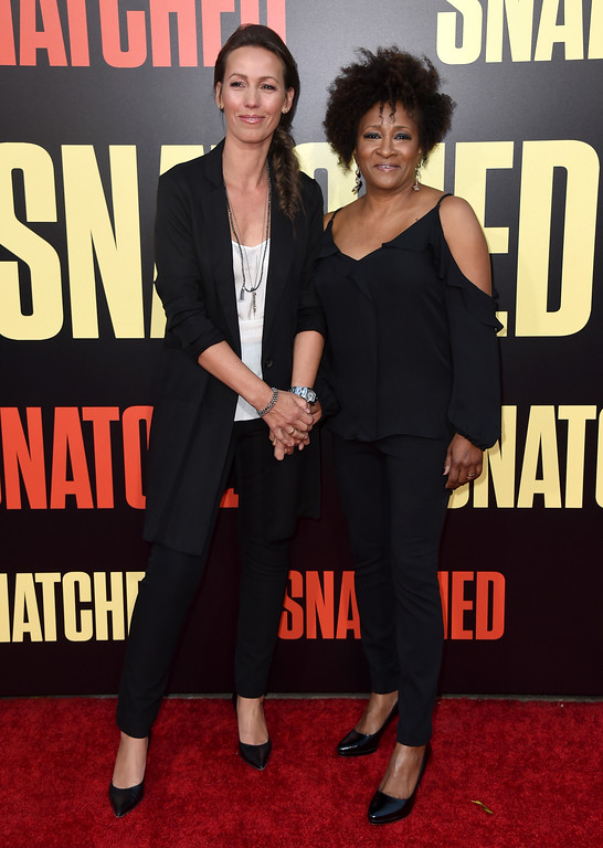". Alex Sykes, left, and Wanda Sykes arrive at the Los Angeles premiere of ""Snatched\"" at the Regency Village Theatre on Wednesday, May 10, 2017. (Photo by Jordan Strauss/Invision/AP)"